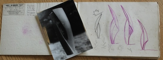 Design sketches and a photograph of a finished piece using the concept
