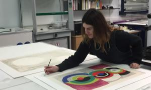 CMAS Archive Conservator Sarah Volter working on signed prints by Barbara Hepworth and Sonia Delauney